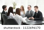 business team holds a workshop... | Shutterstock . vector #1122696170