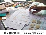 Architect designer Interior creative working hand drawing sketch plan blue print selection material color samples art tools Design Studio