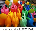 plastic watering can for... | Shutterstock . vector #1122709349