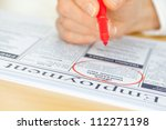 a hand with a pen circling a... | Shutterstock . vector #112271198
