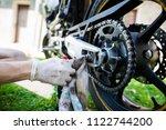 man hands cleaning motorbike... | Shutterstock . vector #1122744200