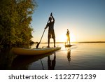 men  friends sail on a sup... | Shutterstock . vector #1122771239