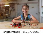 small girl making a robot | Shutterstock . vector #1122777053
