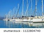a marina in aegean coast... | Shutterstock . vector #1122804740