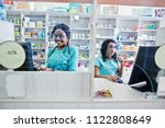 two african american pharmacist ... | Shutterstock . vector #1122808649