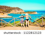 women in chia beach and blue... | Shutterstock . vector #1122812123
