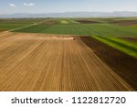 farmer with a tractor on the... | Shutterstock . vector #1122812720