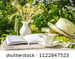 cup with tea  a laptop  a... | Shutterstock . vector #1122847523