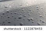 water droplets on the bonnet. | Shutterstock . vector #1122878453