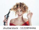hairdresser. satisfied curly... | Shutterstock . vector #1122894446