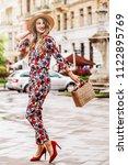 outdoor full length portrait of ... | Shutterstock . vector #1122895769