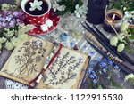 witch book with magic and... | Shutterstock . vector #1122915530