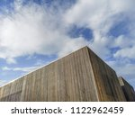 wooden modern building with... | Shutterstock . vector #1122962459