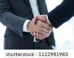 close up of two young male... | Shutterstock . vector #1122981983