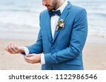 handsome groom at the beach | Shutterstock . vector #1122986546
