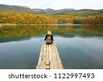 back view of blond hiker woman... | Shutterstock . vector #1122997493
