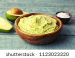 bowl with guacamole made of... | Shutterstock . vector #1123023320