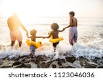 black family having fun on the... | Shutterstock . vector #1123046036