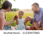 the family with the child... | Shutterstock . vector #1123047083