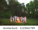 midsummer. young people in... | Shutterstock . vector #1123061789