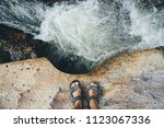 feet of a man in sandals on an... | Shutterstock . vector #1123067336