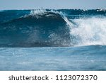 perfect glassy wave breaking on ... | Shutterstock . vector #1123072370