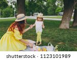woman in yellow clothes play on ...   Shutterstock . vector #1123101989