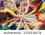 group of children putting their ... | Shutterstock . vector #1123116176