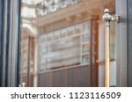 restaurant entrance door with... | Shutterstock . vector #1123116509