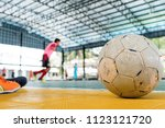 old futsal ball placed on the... | Shutterstock . vector #1123121720