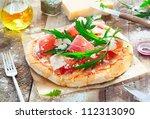 preparing a tasty pizza in the... | Shutterstock . vector #112313090
