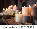 closeup of burning candles... | Shutterstock . vector #1123160123