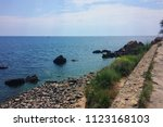 odessa coast with pebbles  blue ... | Shutterstock . vector #1123168103