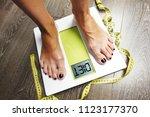 diet word on weight scale...   Shutterstock . vector #1123177370