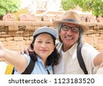 retired couple selfie together... | Shutterstock . vector #1123183520
