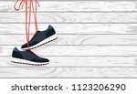 pair of hanging shoes | Shutterstock .eps vector #1123206290