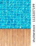 wooden floor edge of swimming... | Shutterstock . vector #1123207199