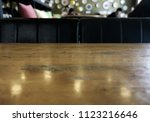 wood table on blur of cafe ... | Shutterstock . vector #1123216646