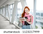 a young red haired student at... | Shutterstock . vector #1123217999