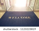 welcome blue mat in front of... | Shutterstock . vector #1123223819