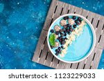 blue smoothie bowl with fruits  ... | Shutterstock . vector #1123229033