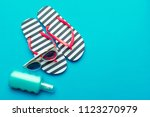 beachwear and accessories on a... | Shutterstock . vector #1123270979