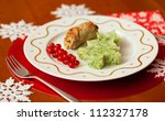 Decorated Christmas dining table with tasty veal and mashed potatoes with broccoli in form of a Christmas tree - stock photo