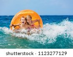 happy kids have fun in sea surf ... | Shutterstock . vector #1123277129