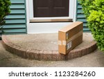 a brown cardboard box is left... | Shutterstock . vector #1123284260