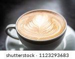latte art coffee in white cup... | Shutterstock . vector #1123293683