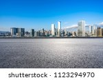 empty asphalt road with city... | Shutterstock . vector #1123294970