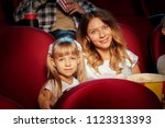 group of friends sitting in... | Shutterstock . vector #1123313393