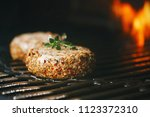 Small photo of lamb burgers spiced by mint and lamb rub on bbq grill with flame