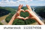 hands heart gesture against... | Shutterstock . vector #1123374506